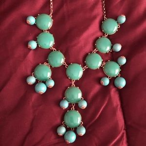 Green and teal colored statement necklace